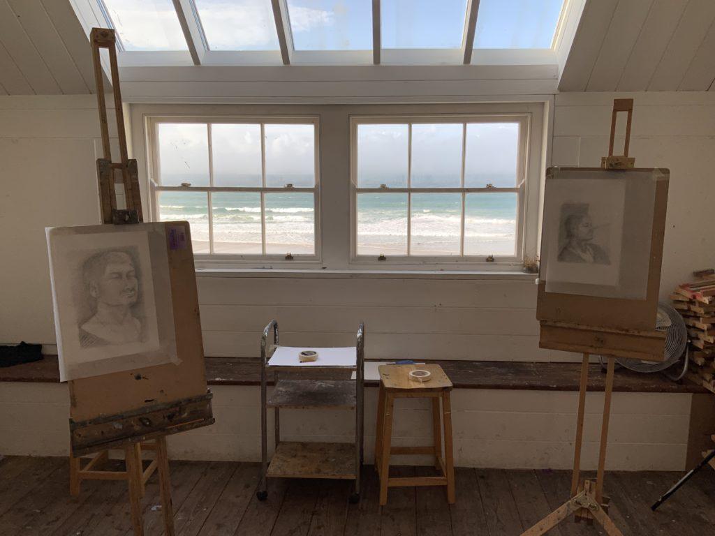 view of Porthemor beach through the windows of art studio