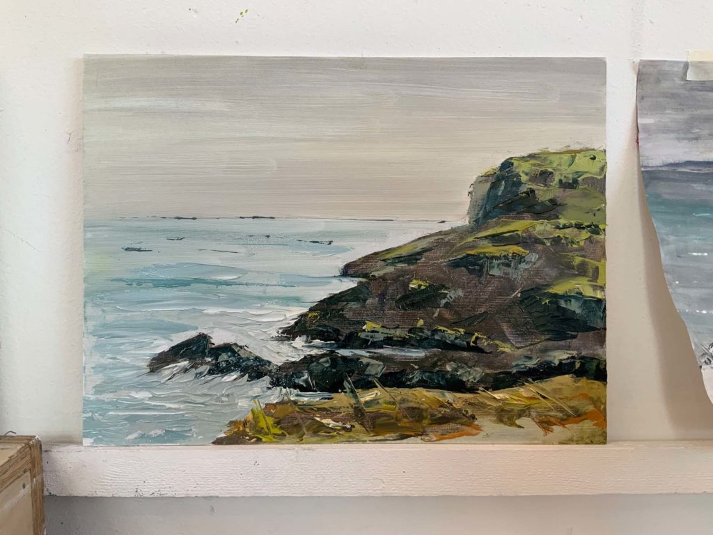 student painting St Ives coast path in acrylic paint